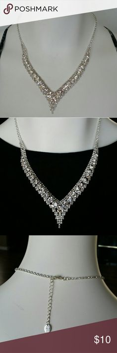 ICING rhinestone necklace Silver tone rhinestone necklace great for prom, wedding or any other special occasion. Only wore once. Left side of the necklace is slightly more curved than the right side as pictured. icing Jewelry Necklaces