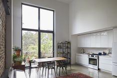 Ikea kitchen in a Brooklyn townhouse remodel by Takatina. Photo by Mikiko Kikuyama. Apartment Kitchen, Kitchen Interior, Kitchen Design, Condo Kitchen, All White Kitchen, Kitchen And Bath, Ikea Kitchen, Kitchen Flooring, Interior Railings
