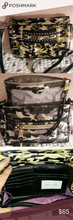 Kathy Van Zeeland NWOT.  Olive, Tan, Black Camo.  Front pocket.  Inside back wall zip pocket, front wall 3 slip pockets. Top zipper closure.  Back pocket & organizer w/2 zip pockets, 2 slip pockets, and slots for 7 cards, attached mirror.  Also comes with add'l ID/card holder for 9 cards.  Adjustable strap.  Smoke free home. Kathy Van Zeeland Bags Crossbody Bags