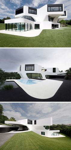 House Exterior Colors - 11 Modern White Houses From Around The World // The curved lines and pops of black against this large white house give it a clean, futuristic look.