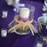 Beach wedding decoration... I like the purple and starfish together!