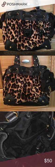 Juicy Couture Velour Leopard handbag Great condition! Slight wear from sitting in closet. Purse has two pockets on the outside sides and two inside pockets as well as inside zipper section. Bag is leopard velour with black leather trim. Bag has lost its shape from sitting empty in closet but once filled will quickly regain shape. Juicy Couture Bags Totes