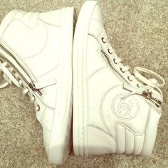 Always authentic worn once CHANEL HIGH TOPS These sneakers are in perfect condition. Worn once! Not available anymore! Selling for double in specialty high end shops because they are impossible to get! Two silver zippers on each side of laces and the outter shoe has the CC logo. Very hot shoe right now!!!! CHANEL Shoes Athletic Shoes