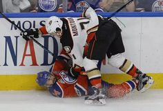 Edmonton Oilers Jordan Eberle (#14) is checked by Anaheim Ducks Brandon Montour during first period action in the the fourth game of their NHL Stanley Cup playoff series in Edmonton on Wednesday May 3, 2017. (PHOTO BY LARRY WONG/POSTMEDIA)