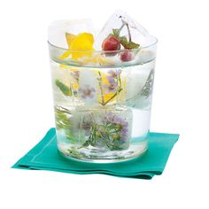 Brides.com: What Your Signature Cocktail Says About You. Vodka Soda with Frozen Flowers for a Garden Wedding
