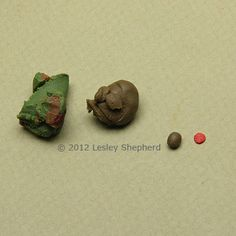 Polymer clay in mid green and mid brown are mixed to make olive green to roll olives. A small amount of red clay works for pimento filling for the olives.