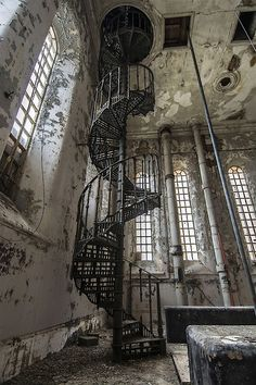 Beautiful wrought iron spiral staircase in derelict building