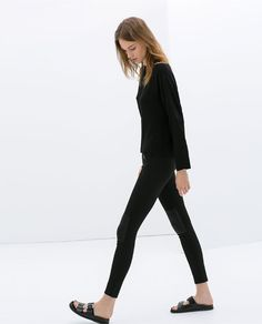 Image 2 of TROUSERS WITH KNEE PATCHES AND ZIPS from Zara