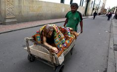 A man transports a sculpture of Christ covered with a blanket on a cart ahead of the forthcoming Holy Week celebrations in downtown Bogota, Colombia
