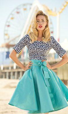 Gray leopard print shirt and full blue bowed skirt