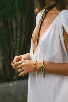 Gold pieces with a black ribbon choker.