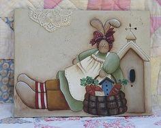 sue conejito y birdhouse