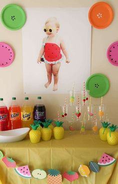 A colorful fruit bar at Paisley's TWO-tti Frutti Birthday Party! Love how they used colorful plastic plates to decorate the walls as fruit!See more party ideas at CatchMyParty.com