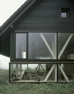 """cubebreaker: """"Zurich-based architect Pascal Flammer designed this timber house in Balsthal, Switzerland, which is sunken with ground-level wrap around windows, connecting it with nature. Design Exterior, Interior And Exterior, Exterior Siding, Interior Ideas, Timber House, Minimalist Home, Minimalist Interior, Minimalist Bedroom, Ground Floor"""