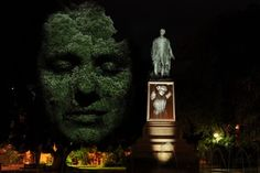 Craig Walsh's art projection of faces on trees this one in Hobart park. Faces move slightly for example blink and wind creates leaf movement which adds to overall lifelike image.