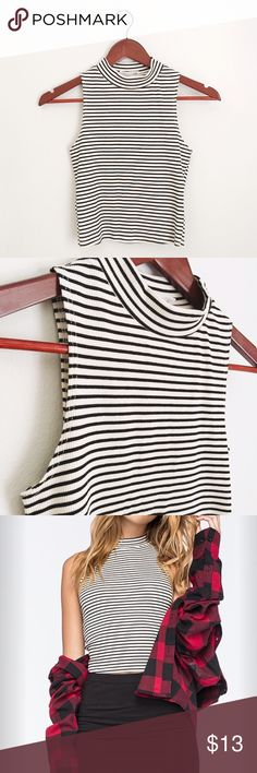 ON TREND Striped Mock Neck Tank ON TREND black and white striped mock neck tank. Pair with your favorite high waisted denim shorts, skirt or jeans for chic styling! Tops Tank Tops