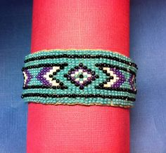 Hand loom beaded bracelet with leather by EVERYTHINGbyERIKA, $40.00