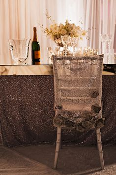 Mirrored table top with sequined silver chair cover & linen