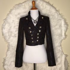 🎉Sale🎉Bebe Brown Short Napoleon Jacket BEBE short Napoleon jacket.  It is a size XXS.  It is made of wool, polyester, acrylic, nylon, and metallic.  It has a subtle shimmer.  It is fully lined.  There are silver button accents. bebe Jackets & Coats Trench Coats