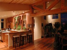 Kitchen of a straw bale house.  I love how warm this looks!