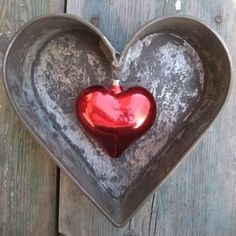 Rustic heart.  Bet they have just used a heart cake pan & attached a red glass heart Christmas ornament to it.
