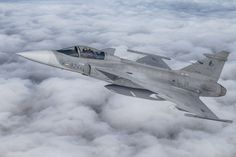 I hadn't shot a Saab Gripen A2A since 2009. So I was quite pleased to see it join up above a stunning layer of clouds!