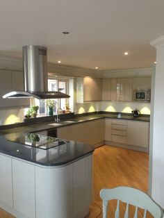 White Kitchen Units With Grey Worktop cream gloss with medium dark wood worktop, grey backgrounds and