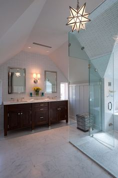Alisberg Parker Architects: Stunning attic bathroom with stained double bathroom vanity and calcutta marble ...