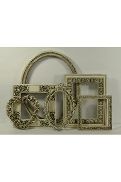 These ivory vintage frames from Etsy would go gorgeously in her room!!