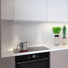 When cutting edge materials such as digitally printed geometric splashbacks and high gloss surfaces with improved scrub resistance can help you design spaces with a high value look. Funky Armchairs, Kitchen Worktop, Countertops, Kitchen, Interior, Kitchen Design, Retro Sofa, Splashback, Patchwork Table Runner