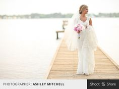 Outdoor bridal shoot on the dock. Unique bridal pose with a long train and bouquet. #wedding #bride #shootandshare #outdoorwedding  |  Photographer: Ashley Mitchell  |  Shoot and Share