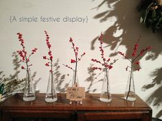 Red berries in stem jars by Violets & Velvet | The Curiosity Project