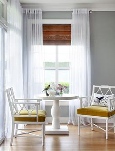 Love the chairs, love the gray walls, love the sheer curtains and the seagrass shade behind them.