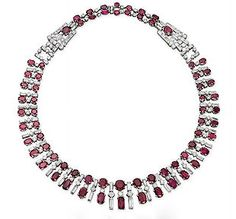 AN ART DECO RUBY AND DIAMOND NECKLACE Designed as a graduated double row of oval-shaped rubies and diamond spacers, alternating with baguette and circular-cut diamonds, mounted in platinum, circa 1930 Art Deco Jewelry, Fine Jewelry, Jewelry Design, Jewellery, Ruby Jewelry, Ruby And Diamond Necklace, Ruby Necklace, Cluster Necklace, Diamond Necklaces