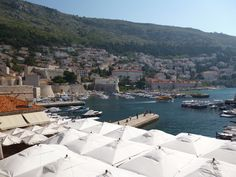 Overlooking Dubrovnik Harbor.  The umbrellas are part of a restaurant.