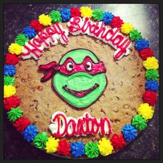 TMNT Cookie Cake For The Birthday Boy! W a big side cup of frosting! yum (this may be what he ends up with) Giant Cookie Cake, Chocolate Chip Cookie Cake, Big Cookie, Cookie Cakes, Birthday Cake Cookies, Turtle Cookies, Turtle Birthday Parties, Birthday Ideas, 5th Birthday