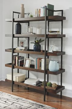 If you're a fan of urban industrial design, it's easy to see why the Starmore bookcase is a bestseller. The blackened gunmetal frame is sleek, sculptural and ultra modern. Beautified with an oiled walnut-tone finish, five gallery shelves stack up . Metal Bookcase, Etagere Bookcase, Bookshelves, Vintage Bookcase, Contemporary Bookcase, Modern Shelving, Contemporary Design, Black Furniture, Home Office Desks