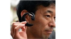 Kazuhiro Taniguchiand his team at the Hiroshima State University have developed a wearable PC that looks like a clip on earphone. Weighing 17 grams, the wireless device has bluetooth support, a GPS compass, a gyro-sensor, microphone and more. It will allow users to navigate through apps on mobile devices using facial gestures such as raising your eyebrows. It uses infrared sensors to detect tiny motions in the ear to do this. #wearables #whyisit #computer #technology #innovation #handsfree