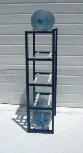 """5 Bottle Vertical Water Bottle Storage Rack - Black (Black) (50""""H x 13""""W x 21""""D) by Sha Co. $254.00. Small Footprint. Several Sizes Available. Size: 50""""H x 13""""W x 21""""D. Color: Black. American Welded Steel. The 5 Bottle Vertical Water Bottle Storage Rack - Black is ideal for the home or office! These water bottle stands hold 5 gallon water bottles safely on American welded steel constructed racks. These 5 gallon water stands use the same construction as the water bottle industry'..."""