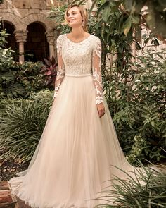 Rebecca Ingram wedding dress CARRIE LEIGH. This modest long sleeve princess wedding gown from @maggiesottero Spring 2021 features dreamy and airy layers. #Ad #MaggieSottero #RebeccaIngram #MaggieBride #RealBride #WeddingDress #WeddingGown #WeddingInspiration #FlirtyWeddingDress #AffordableWeddingDress