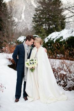 winter wedding cape - photo by helen cawte photography