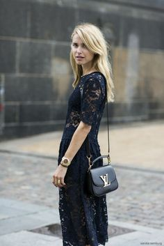 Pernille Teisbaek in all black wearing a lace dress and carrying Louis Vuitton shoulder. Bag #StreetStyle