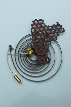 Pin. peridot, steel click spring, found object, 14KY. $650 | Flickr | Lisa Ben-Zeev