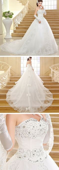 This ball gown wedding dress is gorgeous! It has a sweetheart neckline, lace, crystals and bows down the train. Use code PTL20331 to save money on it.