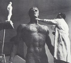 "Arno Breker working on his ""Dionysos"" sculpture in 1936. Unlike much of the other art on this list, the Nazis adored German sculptor Arno Breker. With his idealized masculine forms, he was a highly favored artist for public art commissioned by the Nazis. However, post World War II about 90% of that art was destroyed by the Allies."