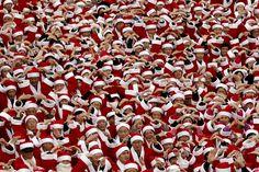 Korean volunteers wearing Santa Claus costumes