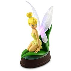 This charming Light-Up Tinker Bell Figure will make a glowing addition to any home. Created by Disney artist Randy Noble, this glittering sculpture features the little fairy as she rests on a leaf and gives her translucent illuminated wings a rest. Tinkerbell Disney, Disney Fairies, Disney Princess, Disney Figurines, Collectible Figurines, Tinker Bell, Disney Parks Merchandise, Disney Artists, Disney Love