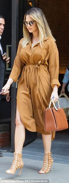 Casually chic:As always, Chrissy looked amazing with the new mom rocking a rust coloured ...