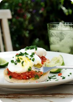 poached eggs on tomato chilli sauce