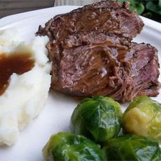 Slow cooker pot roast - use red wine and beef stock instead of water